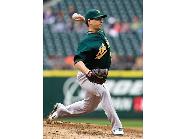Oakland Athletics starter and Saugus graduate Tom Milone delivers a pitch during the first inning of a baseball game against the Seattle Mariners in Seattle on Sunday. He joined James Shields and Zach Britton as former Santa Clarita Valley pitchers to start for an MLB team on Sunday.