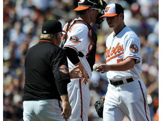 Baltimore Orioles starting pitcher and former Canyon High player Zach Britton, right, is pulled from the game by Baltimore Orioles manager Buck Showalter, left, against the New York Yankees during the fourth inning on Sunday in Baltimore. The Yankees won 13-3.