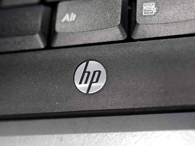 In this Monday, Aug. 20, 2012, photo, a Hewlett Packard keyboard is displayed at a Best Buy store in Mountain View, Calif. on Aug. 22, Hewlett-Packard Co. said it suffered an $8.9 billion loss during its most recent quarter.