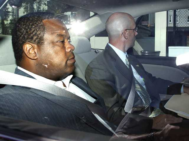 Trenton Mayor Tony Mack, left, is driven in custody into the federal courthouse in Trenton, N.J., Monday.