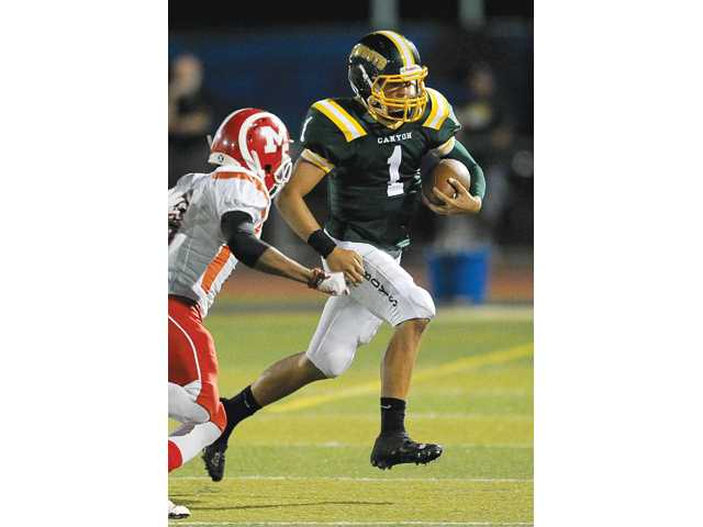 Canyon High quarterback Cade Apsay (1) threw for a school-record 405 yards in Friday's win over Knight.