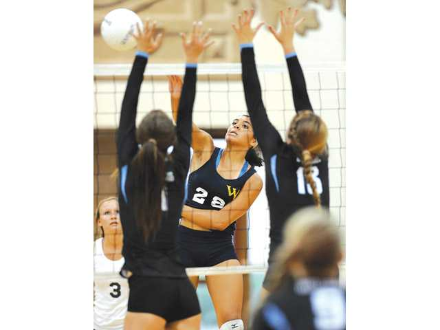 West Ranch's Alexis Clewis scores a kill against Buena on Tuesday afternoon at West Ranch High School.