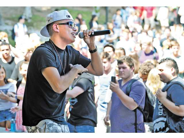 "Hip Hop singer, Young Love, aka Anthony Mercado, 17, performs his original composition ""Before You We Stand"" during a Patriot Day lunch time performance at Canyon High School on Tuesday."