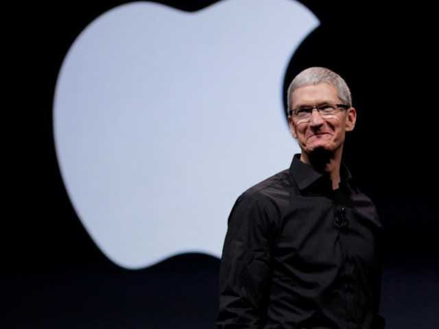 Apple CEO Tim Cook walks on stage at the beginning of an event in San Francisco, Wednesday. Apple is holding an event in San Francisco during which it is expected to announce a new iPhone capable of faster data speeds.