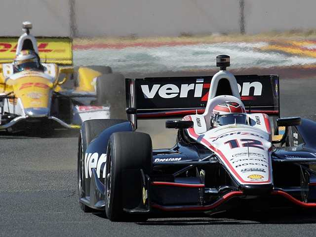 Will Power (12), of Australia, leads Ryan Hunter-Reay, of the United States, during practice for the IndyCar Series auto race Friday, Aug. 24, 2012, in Sonoma, Calif.