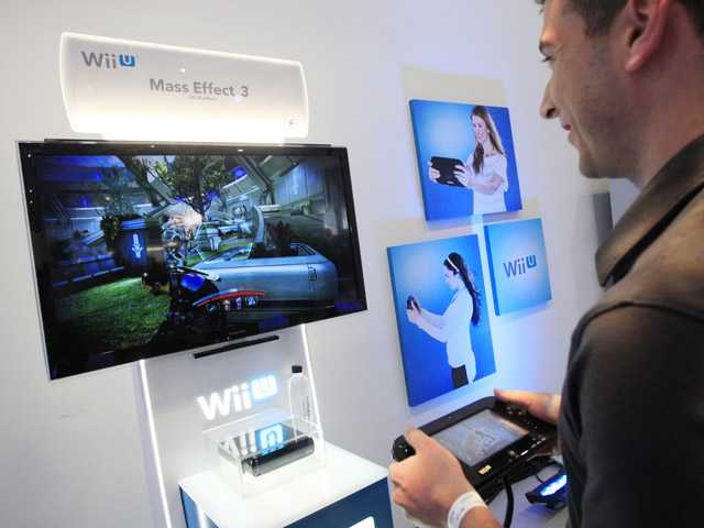Nintendo's Wii U GamePad and console are unveiled on Thursday in New York.