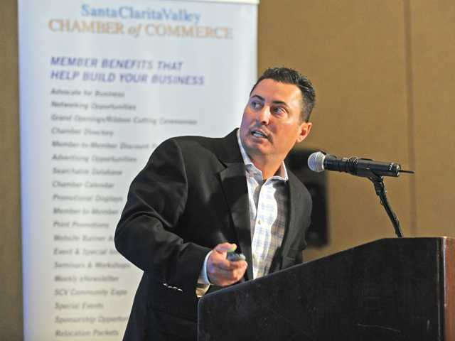 Chris Angelo speaks at SCV Chamber of Commerce luncheon on Thursday.
