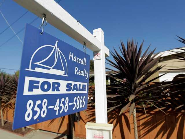 A house is for sale in San Diego June 13, 2012. Southern California home prices hit a four-year high in August, further evidence of housing rebound.