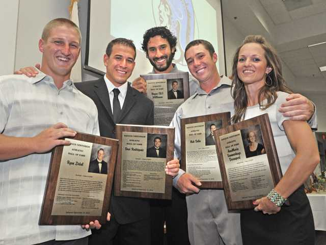 (From left to right) Saugus graduates Ryan Zirbel, Desi Rodriguez, B.J. Willkomm, Nick Delio and AnnMarie Summerhays-Davenport were inducted into the school's athletic hall of fame Thursday.