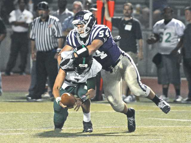 Valencia's Jordan Nguyen (54) sacks Palmdale quarterback Jake Dashnaw on Aug. 31 at Valencia High. The Vikings lost the game 35-21 and are 0-2 thus far this season. Valencia hosts Righetti tonight.