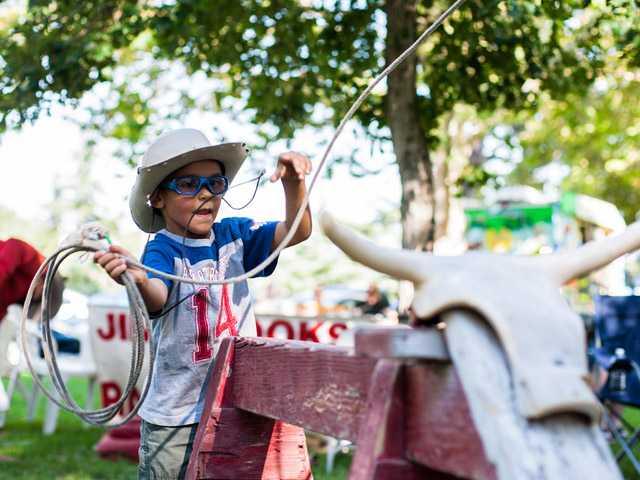 "Kacper Paul, 6, of Santa Clarita, tries his hand at roping a ""steer"" Saturday at William S. Hart Park in Newhall."
