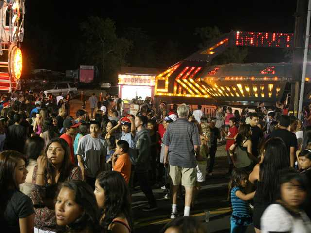 Crowds gather at the fair, which continues through the weekend.