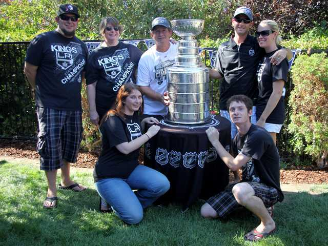 The Zager family takes a portrait with the Stanley Cup on Saturday. (Top row, left to right), son in law Brian DiValerio, mother Renee Zager, father Ken Zager, son Jeremy Zager, Jeremy Zager's wife Jennifer Zager. (Bottom row left to right) daughter Laura DiValerio and son Andy Zager.