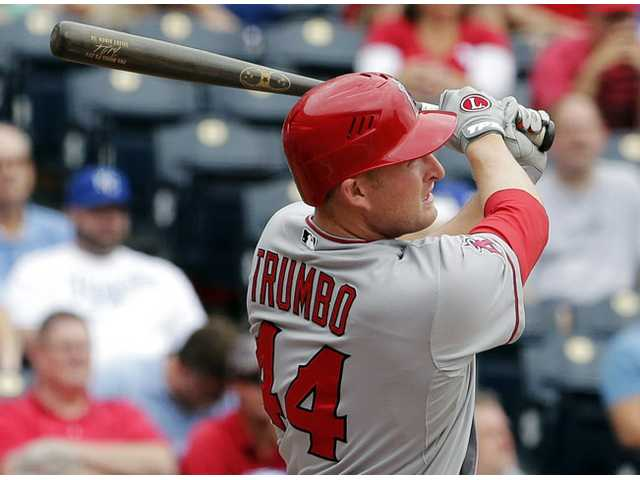 Los Angeles Angel Mark Trumbo hits a three-run home run against the Kansas City Royals on Sunday in Kansas City, Mo.