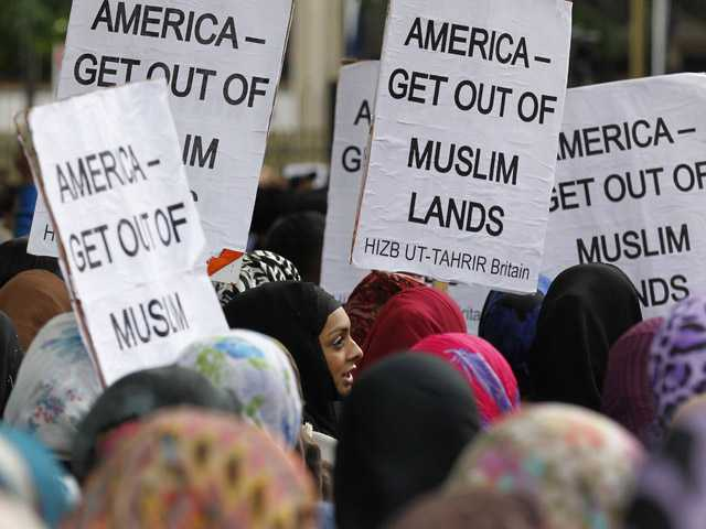 Supporters of Islamic political movement Hizb ut-Tahrir protest outside the US Embassy in London against the US made anti-Muslim film mocking the Prophet Mohammad.