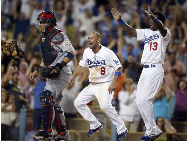 Los Angeles Dodgers Shane Victorino, center, and Hanley Ramirez celebrate their team's 4-3 win over the St. Louis Cardinals on Saturday in Los Angeles.
