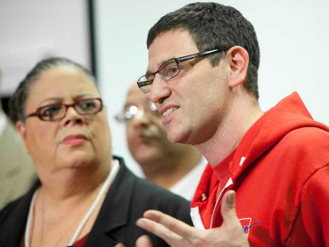 Chicago Teachers Union President Karen Lewis, left, listens to CTU Vice President Jesse Sharkey speak at a press conference following a meeting of delegates Sunday in Chicago.