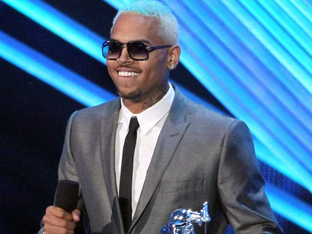 In this Sept. 6 file photo, Chris Brown accepts the award for best male video at the MTV Video Music Awards in Los Angeles.