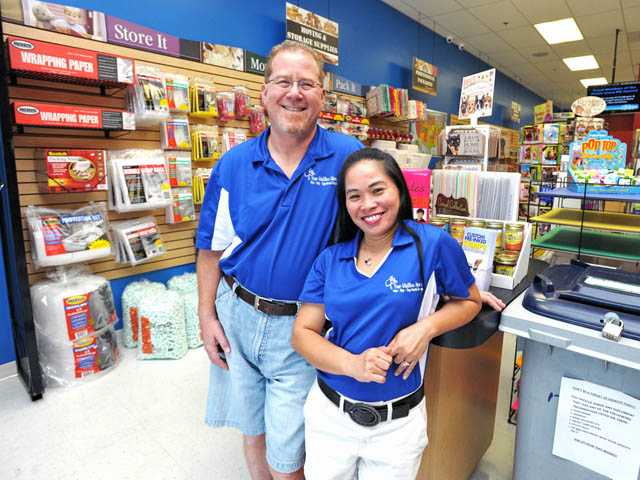 Owners Barry, left, and Shirley Singer stand at Your-MailBox-Store in Newhall on Monday.