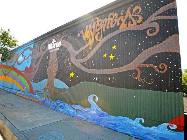 A mural of the ARTree community arts center is seen on the side of the Newhall Community Center's warehouse building on the 24200 block of Railroad Avenue in Newhall on Monday.