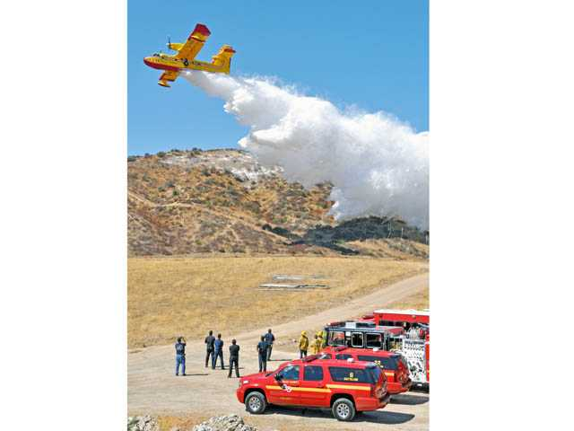 "Los Angeles County Fire Department conducts a training exercise in the hills near Castaic on Sept. 7 with the CL 415 ""Super Scooper"" planes as brush season approaches."