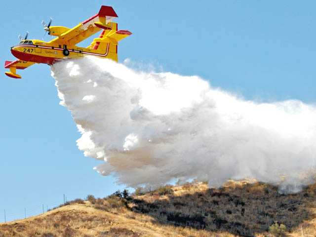 "Los Angeles County Fire Department conducts a training exercise in the hills near Castaic on Sept. 7 with the CL 415 ""Super Scooper"" planes as brush season approaches. The planes are leased from September through December and are used to combat wildfires."