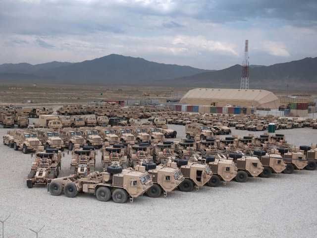 In this May 24 photo provided by the U.S. Army, various military vehicles are seen parked after being cleaned and stripped for shipment  at the Kandahar Air Field south of Kabul, Afghanistan.