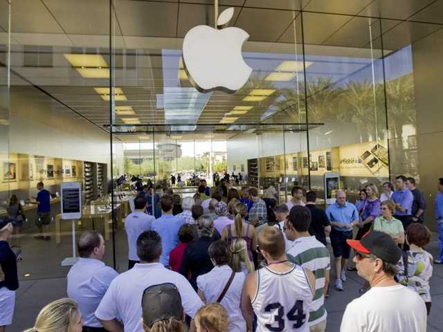 A line of customers enter an Apple store in Scottsdale, Ariz. in 2011. Delivery times climbed quickly as Apple Inc. started taking orders for the iPhone 5 on Friday, Sept. 14, 2012, suggesting strong demand.