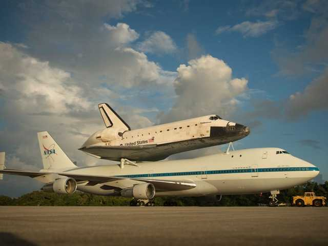 This photo provided by NASA shows space shuttle Endeavour atop NASA's Shuttle Carrier Aircraft at NASA's Kennedy Space Center on Sept. 17. Endeavour's final flight to California has been postponed by weather.