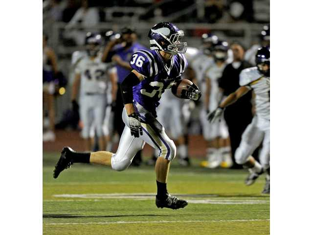 Valencia's Stone Jackson (36) runs to the end zone for a score against Righetti on Friday at Valencia High.