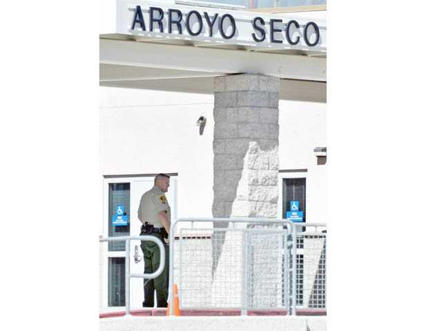 A Los Angeles County sheriff's deputy is stationed at Arroyo Seco Junior High School in Saugus on Tuesday.