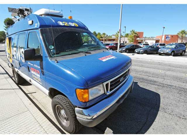A television news-gathering truck is seen outside Arroyo Seco Junior High School in Saugus on Tuesday.