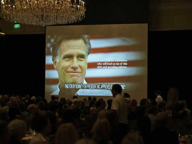 A campaign film is shown before Mitt Romney speaks at a fundraiser in Salt Lake City, Utah on Tuesday.