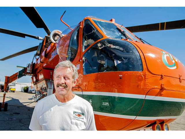 Mike Lacy is a pilot for the Erickson Air Crane at the Los Angeles County Fire Department's Van Nuys Fire Tanker Base. The helicopter can carry a load of about 2,500 gallons of water to drop on fires, and can refill in under a minute.