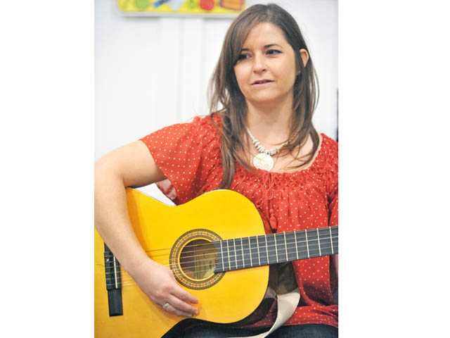 Mindy Cabral welcomes students to her music class at the Little School of Music in Valencia on Tuesday.