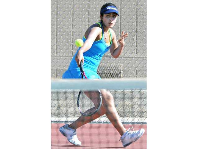West Ranch High No. 2 singles player Noor Makan hits a return against Hart High on Tuesday at Hart High School.