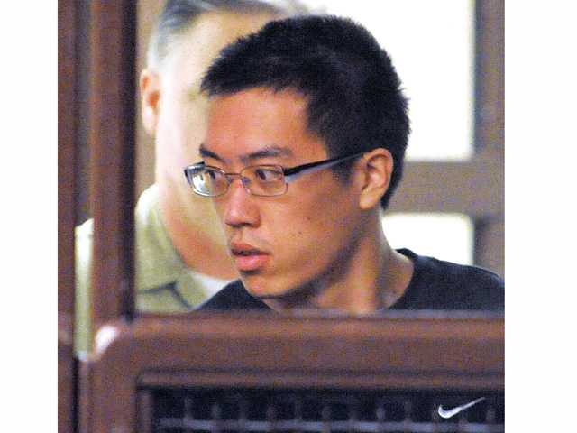Eric Yee, 21,  enters the court room at his arraignment hearing at San Fernando Courthouse in San Fernando on Wednesday.