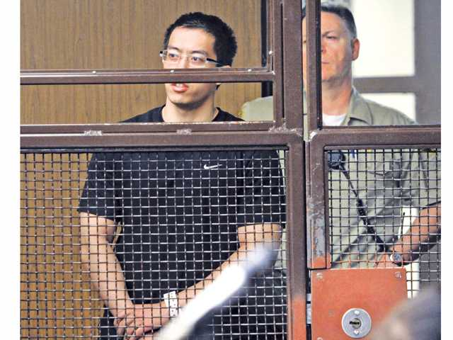 Eric Yee, 21,  responds to a question from the judge at his arraignment hearing at San Fernando Courthouse in San Fernando on Wednesday.