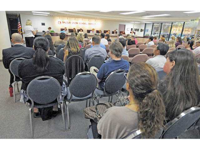 About 100 people attend a meeting of the Saugus Union School District board in Valencia regarding the proposed Einstein Academy charter on Wednesday.