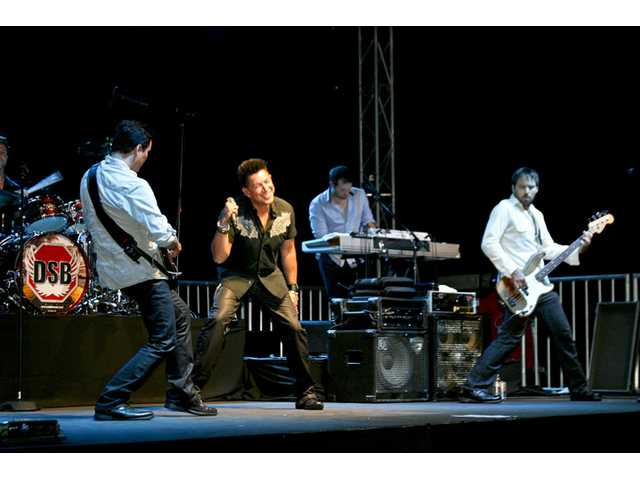 "Lead singer Juan del Castillo and the DSB tribute band performed Journey's biggest hits at the annual ""Evening Under the Stars"" gala for the Michael Hoefflin Foundation at the Mann Biomedical Park on Sept. 15."