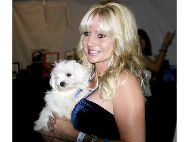 "Carolyn Grijalva won the adorable three-month-old male Maltese puppy for $3,000 at the 19th annual Michael Hoefflin Foundation ""Evening Under the Stars"" gala on Sept. 15."