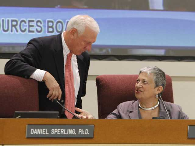California Air Resources Board Member Ron Roberts talks with ARB chair Mary Nichols during a hearing held Thursday in Sacramento.