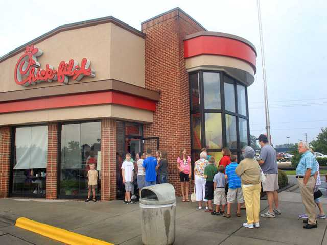 In this Aug. 1 file photo, customers line up outside the Chick-fil-A Restaurant at New Bern Mall in New Bern, N.C.