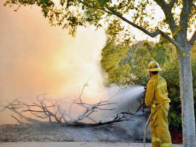 A firefighter battles a blaze at Pamplico Park on Thursday. Photo courtesy of Rick Herrmann.