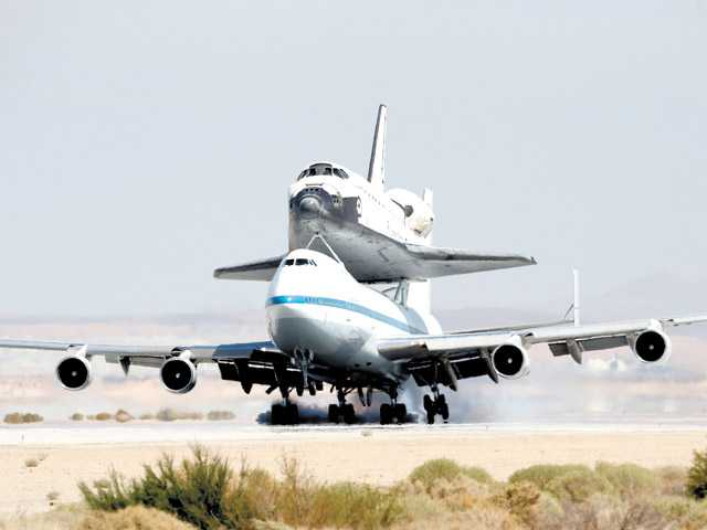 Space Shuttle Endeavour mounted on NASA's Shuttle Carrier Aircraft lands at Edwards Air Force Base on Thursday.