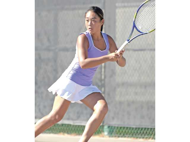 Valencia singles player Katelyn Choi approaches a ball to return on Friday at Valencia High School.