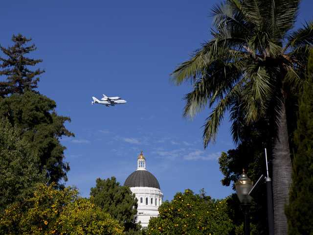 Space Shuttle Endeavour mounted on NASA's Shuttle Carrier Aircraft (SCA) flies over Sacramento on Friday.