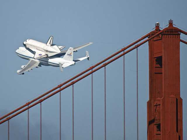 The space shuttle Endeavour passes over the Golden Gate Bridge in San Francisco on Friday.