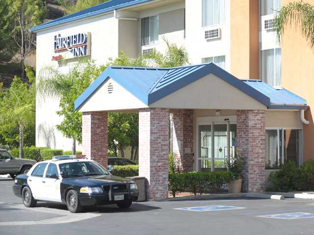 An L.A. County Sherriff's patrol car sits parked in front of the Fairfield Inn in Stevenson Ranch after the hotel was robbed on Friday morning, the suspect escaped in a black SUV.