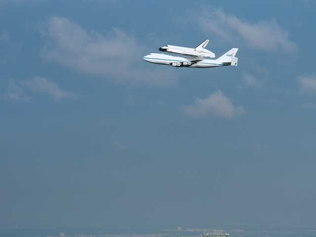 The space shuttle Endeavour, carried atop NASA's 747 Shuttle Carrier Aircraft, passed over the downtown Houston on its way to Los Angeles where today it is soaring over crowds in the L.A. area.Endeavour is soaring over Los Angeles after wowing crowds in Northern California with low flyovers.